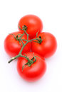 Bunch of red tomatoes on a white background Stock Image