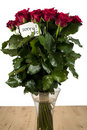 A bunch of roses in glass vase with note Royalty Free Stock Images