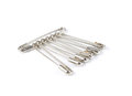 Bunch of safety pins on white background, shiny metal safety pin Royalty Free Stock Photo