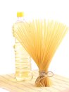 Bunch spaghetti oil on a table napkin white background Royalty Free Stock Photography