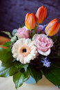 Bunch of spring flowers freesias tulips ranunculus and hyacinths Stock Image