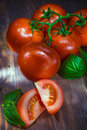 Bunch of tomato on board shot with creative lighting Royalty Free Stock Photo