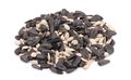 Bunch of white and black sunflower seeds on background Stock Images