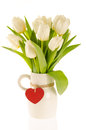 A bunch of white tulips in a jug with the red heart Stock Images
