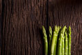 Bunches of asparagus on a wood background. Royalty Free Stock Photo