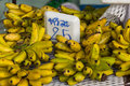 Bunches of banana on table in market Royalty Free Stock Photo