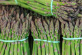 Bunches of green asparagus fresh on a market Stock Photo