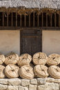 Bunches of straw rope ropes leaned against a wall Stock Photo