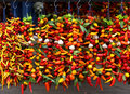 Bunches of various colorful peppers at the market Stock Photos