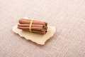 bundle of Cinnamon sticks on canvas Royalty Free Stock Photo