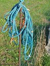 Bundle of cord blue nylon rope hang on country yard fence Stock Images