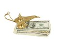Bundle of dollars and magic lamp of aladdin isolated on white background Royalty Free Stock Photography