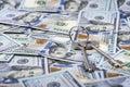 Bundle of keys on dollar bills background Royalty Free Stock Photo