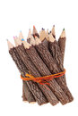 Bundle of tree trunk pencils isolated on white background Stock Photography