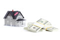 Bundles of dollars in front of home Royalty Free Stock Photo