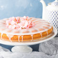 Bundt cake with frosting. Festive treat spring flowers Royalty Free Stock Photo
