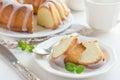 Bundt cake with sugar glaze on white background Stock Image