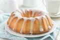 Bundt cake with sugar glaze on white background Royalty Free Stock Photo