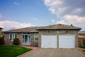 Bungalow with a double garage attractive family home brick Royalty Free Stock Photo