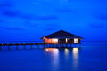 Bungalow the in the evening maldives Royalty Free Stock Photo