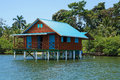 Bungalow on stilts over water of the caribbean sea bocas del toro panama Royalty Free Stock Photo