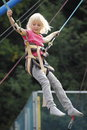 Bungee young girl have fun with jumping Stock Image