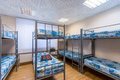 Bunk metal beds in hostel room Royalty Free Stock Photo