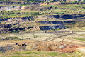 Bunk wall surface mine with exposed colored minerals and brown coal, view from above Royalty Free Stock Photo