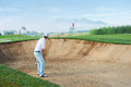 Bunker shot golf from sand golfer hitting ball from hazard Royalty Free Stock Photos