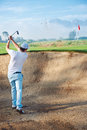 Bunker shot golf from sand golfer hitting ball from hazard Royalty Free Stock Photo