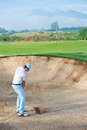 Bunker shot golf from sand golfer hitting ball from hazard Royalty Free Stock Photos