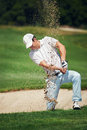 Bunker shot golf from sand golfer hitting ball from hazard Royalty Free Stock Image