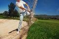 Bunker shot golf from sand golfer hitting ball from hazard Stock Images