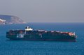 Bunkering tanker Vitaly Vanyhin a large container ship Mataquito anchored in the roads. Nakhodka Bay. East (Japan) Sea. 02.03.2015 Royalty Free Stock Photo