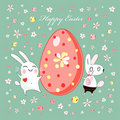 Bunnies  with Easter eggs Stock Image