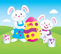 Bunnies Painting A Large Easter Egg Royalty Free Stock Photos