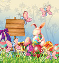 The bunny and the butterflies in the garden with easter eggs illustration of Royalty Free Stock Image