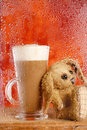 Bunny and coffee latte behind rainy window Royalty Free Stock Photography