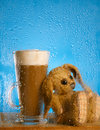 Bunny and coffee latte behind rainy window Stock Photo