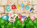 A bunny hiding with easter eggs illustration of Stock Photo