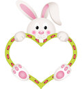 Bunny holding blank heart Image stock