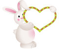 Bunny holding blank heart mignon Photo stock