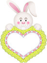 Bunny holding embroidered heart Lizenzfreies Stockfoto