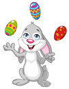 Bunny juggling easter eggs Stock Image