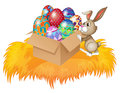 A bunny pushing a box full of easter eggs illustration on white background Stock Photos