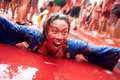Bunol spain august the man lies and laughs in tomato slus slush on tomatina festival Stock Photo