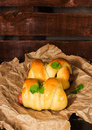 Buns with frankfurter fresh biscuits on a rustic background Stock Photo