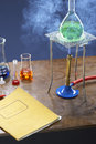 Bunsen burner heating flask with science equipment in laboratory Royalty Free Stock Photo