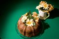 Bunt cake fresh home baked chocolate with floral arrangement Royalty Free Stock Image