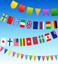 Bunting flags and country flags on a blue sky Stock Image